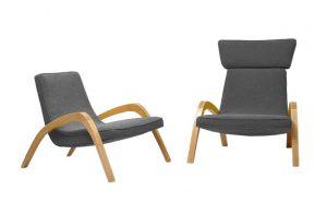 Dve dizajnové relaxačné kreslá JAZZ a JAZZ MAX, jedno bez hlavovej opierky, v šedom čalúnení.